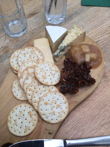 Cheese platter with fig paste and apple sauce