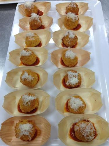 Smoked cheese and roast pumpkin risotto balls with Napoli sauce and parmesan snow