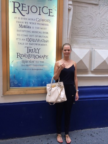 Arabella beside one of the posters outside the Theatre