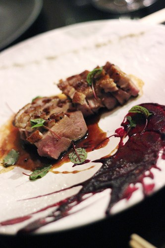 Duck breast with wasabi jus, beetroot and blueberry sauce and sichuan pepper