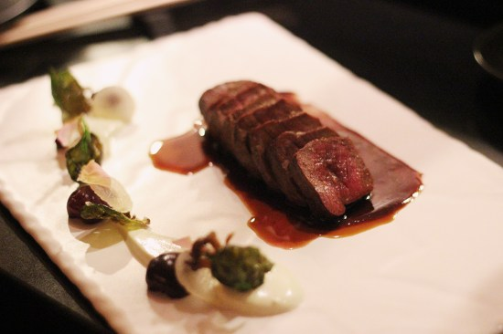 Venison smoked on hay with a cherry and gooseberry jus
