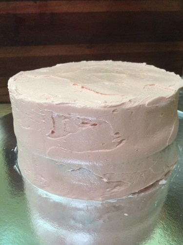 Cover cake in a layer of frosting.