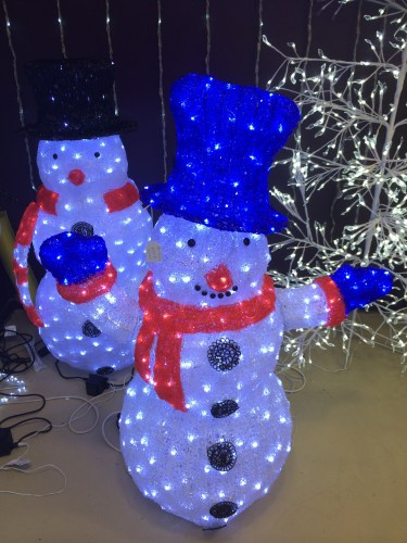 Snowmen lit up like Christmas trees