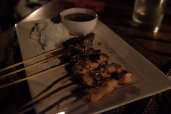 Half Dozen Chicken and Beef Satay Skewers with Rice:  about $9.50