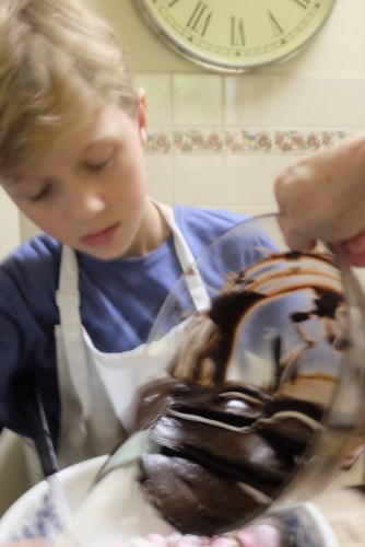 Pouring the chocolate into the nut mixture