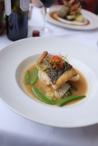 Pan- fried Cone Bay Barramundi fillet, Thai sour curry broth with fresh Parklands vegetables finished with lime leaves
