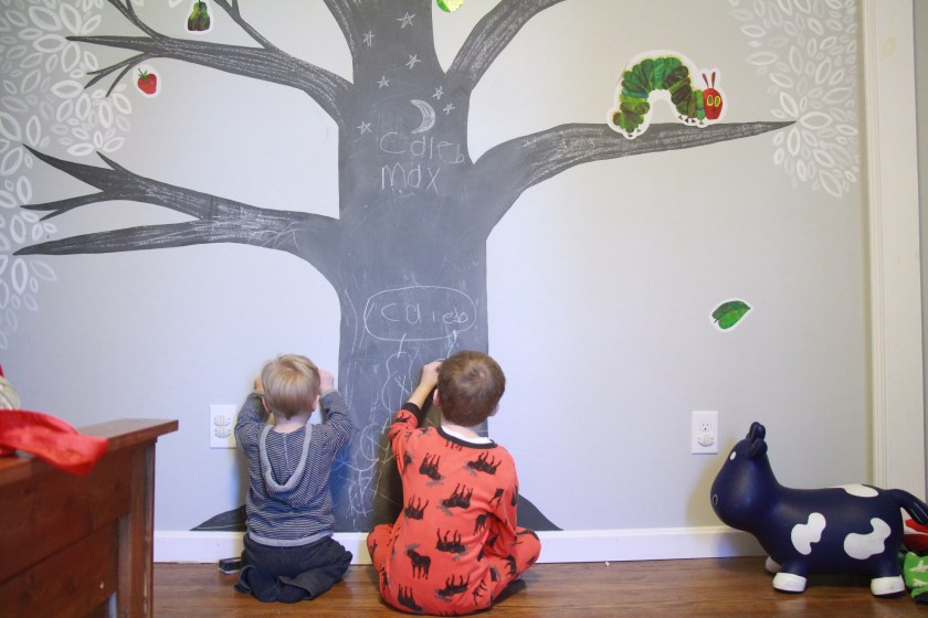 Writing on the chalkboard tree in Max's room