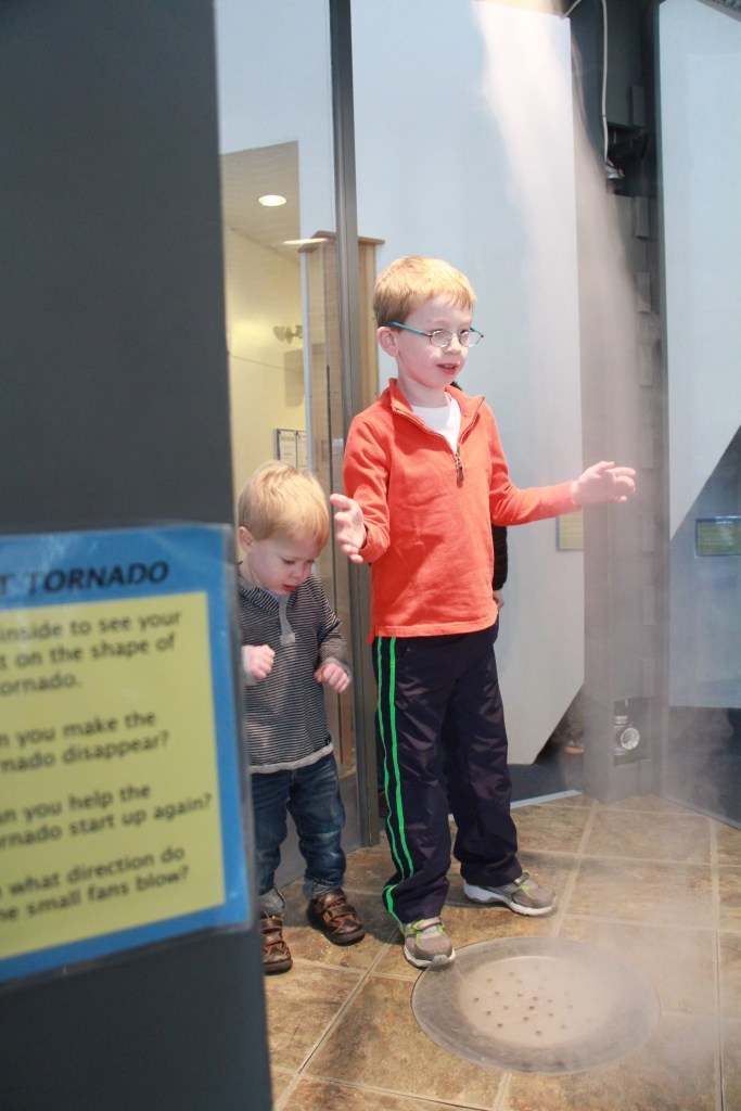 playing in the tornado at acton science museum