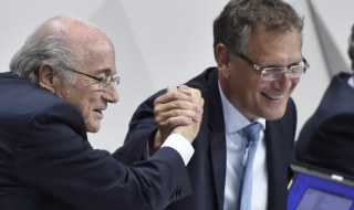 FIFA President Sepp Blatter (L) makes a symbolic handshake with FIFA general secretary Jerome Valcke during the 65th FIFA Congress in Zurich on May 29, 2015. Blatter heads into a re-election vote amid FIFA's corruption scandal adamant that only he can clean up the world's most popular sport, to the dismay of critics who want to issue a red card to his 17-year rule.  AFP PHOTO / MICHAEL BUHOLZERMICHAEL BUHOLZER/AFP/Getty Images