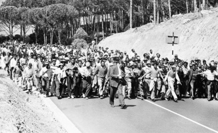 Black South Africans jam a road in Cape Town, March 30, 1960, on their way to demonstrate in front of a police station in protest against the jailing of their leaders.  Police arrested more than 100 leaders of political parties opposed to the government's racial policies in a series of pre-dawn raids. (AP Photo)