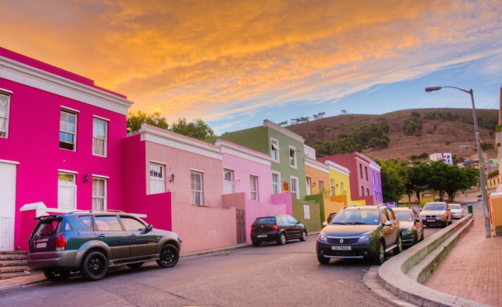 Bo-kaap in the old Malay quarter of Cape Town South Africa with Signal Hill behind the colorful homes just before sunset