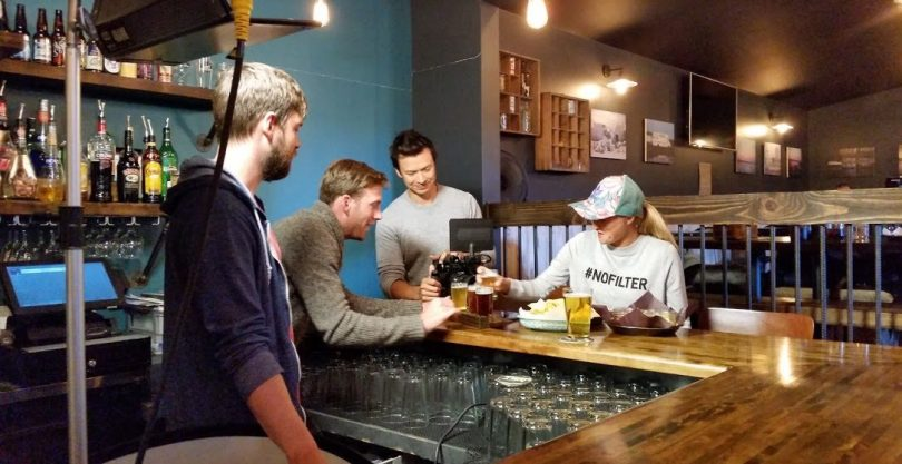 Lordon (second from the left) setting up a tasting scene at a mircobrewary in NWT Image: Ryan Cox