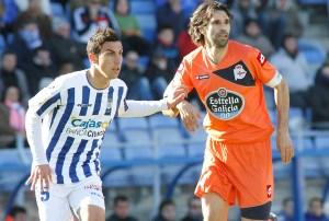 Bonaque con Valerón, auntor del único gol del partido. (J. Pérez)