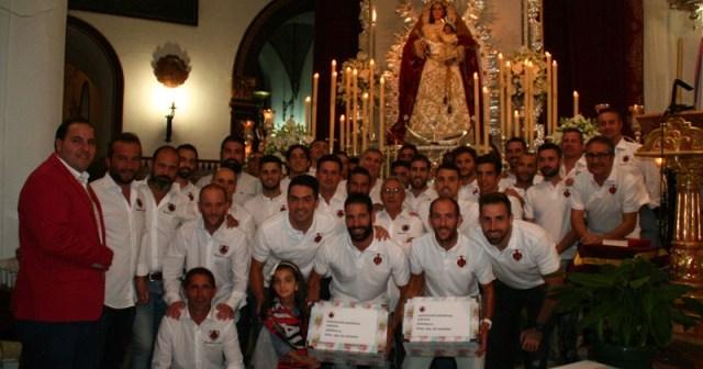 Ofrenda floral de la AD Cartaya a la Virgen del Rosario.