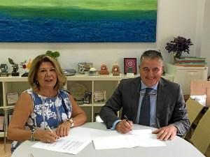 Foto firma del convenio AFA