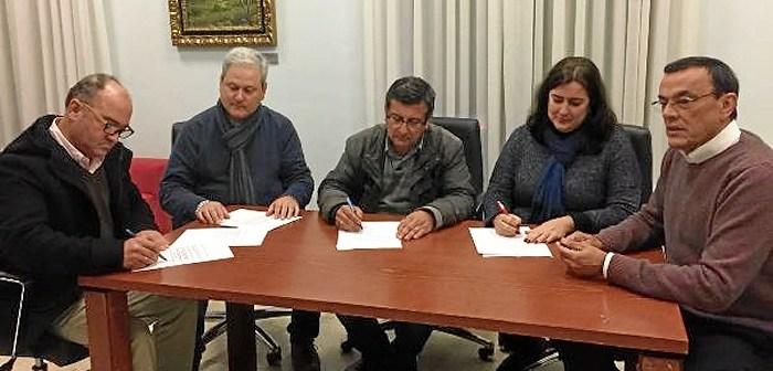 Firma del acuerdo tripartito.