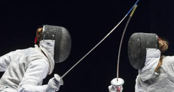 epa04790164 A photograph made available on 09 June 2015 showing Elisa Di Francisca, of Italy, (L), competes against Larisa Korobeynikova, of Russia, (R), during women's foil final at the European Fencing Championships in Montreux, Switzerland, 08 June 2015.  EPA/DOMINIC STEINMANN