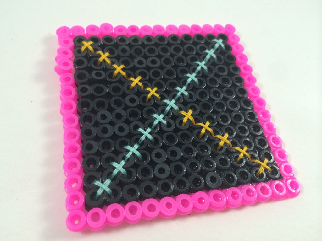 Fuse bead cross stitching by Hugs are Fun
