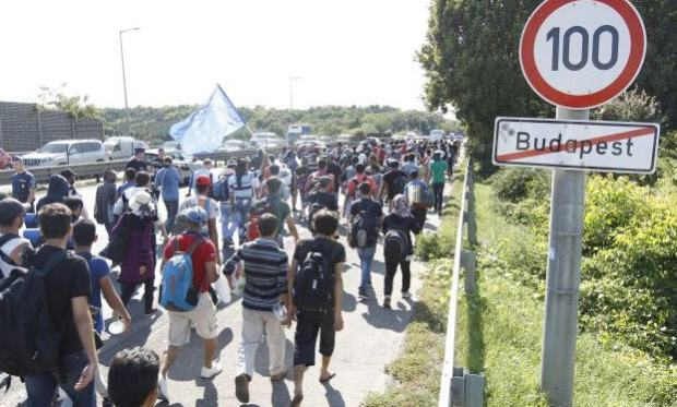 The marching refugees just leaving the city limit of Budapest