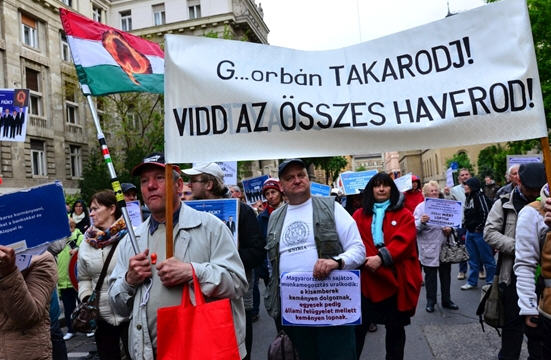 "The victim's of Tarsoly's pyramid game The sign reads: ""Orbán get lost and take your cronies along"""