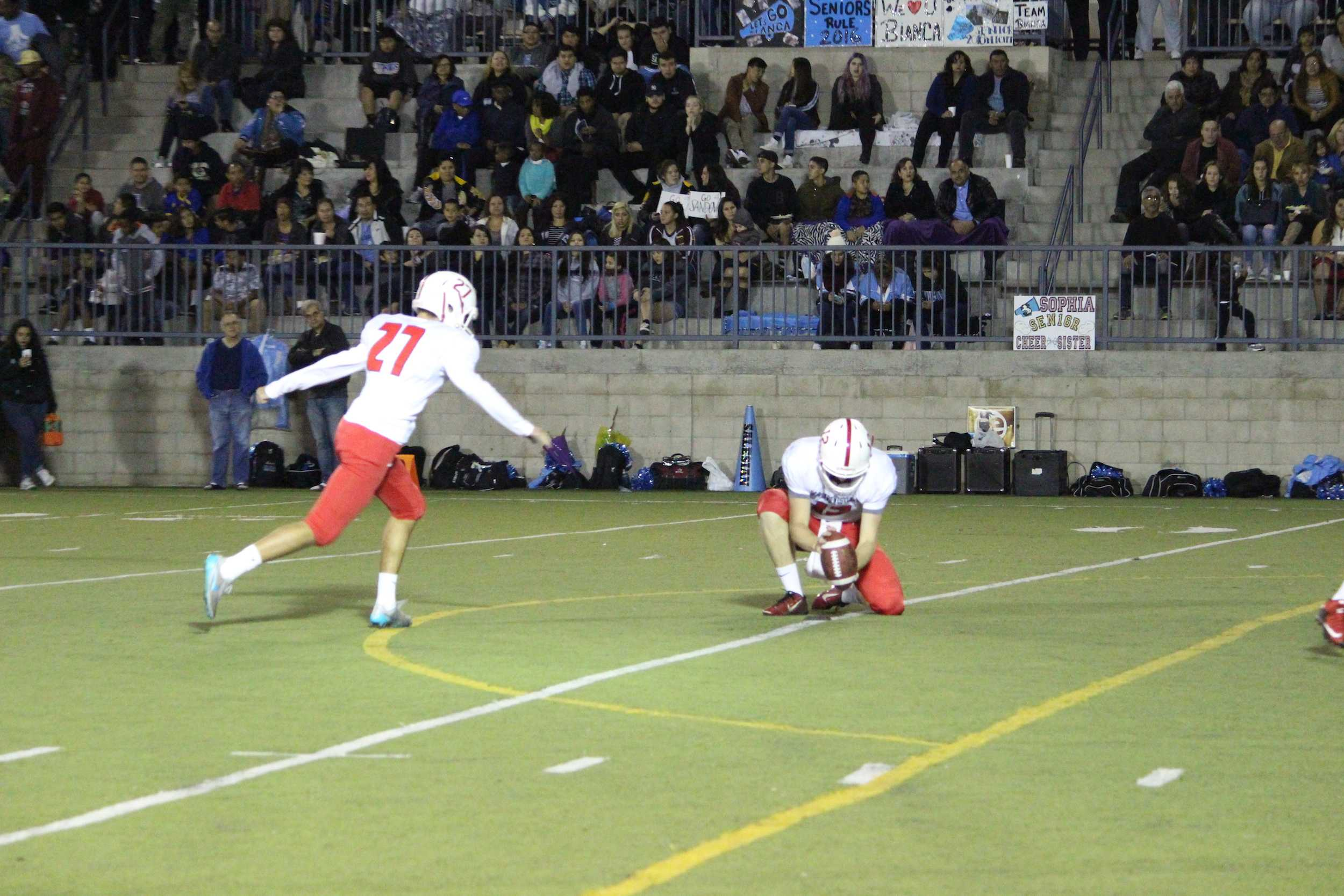 Josh Lyons '17 kicks an extra point.