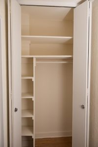 Spacious closet in an efficiency unit.