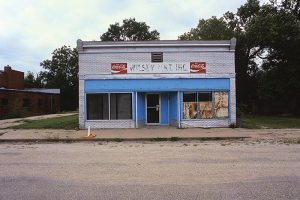 Closed store, Wilsey, Kansas. There were often caches of excellent hand quilted quilts in such burgs.
