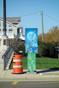 A similarly enhanced transformer box photographed by Crystal on Atlantic Avenue in Atlantic City.  There seems to be a widespread effort to decorate all manner of objects in public spaces. As well as paint, art groups cover utility poles and sculpture with knitted cozies. This practice is called yarn bombing.  Click to enlarge.