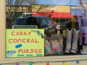 There are goods like a conceal-and-carry holster available in old downtown Branson that are not sold in the trendy corporate outlets of Branson Landing. (click to enlarge)