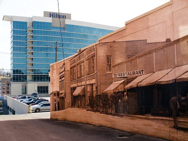 The twelve-story Hilton Branson Convention Center Hotel separates the spanking new Branson Landing Shopping Mall from the old downtown. Combining the past with the present is a time-honored craft in Branson.