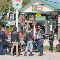 In the HYPERCOMMON universe there's nothing odd about a group of Japanese guys on Harleys enjoying a recreated gas station on a vanished highway.