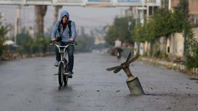 Photos give a rare glimpse of daily life during Syria's ...