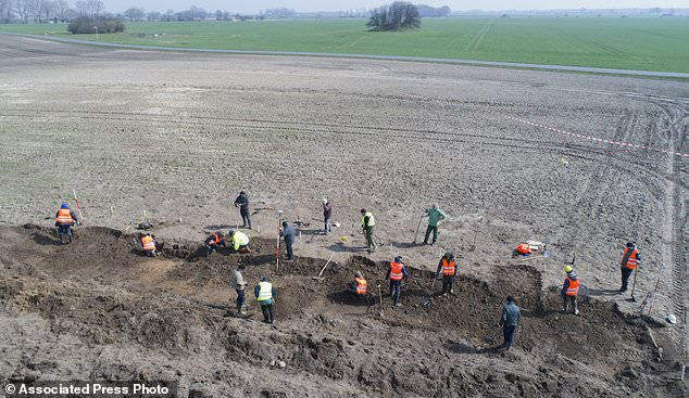 The state's archaeology office became involved after the initial find, digging an exploratory trench covering 400 square metres (4,300 square feet). This revealed the entire treasure, which was recovered by experts last weekend
