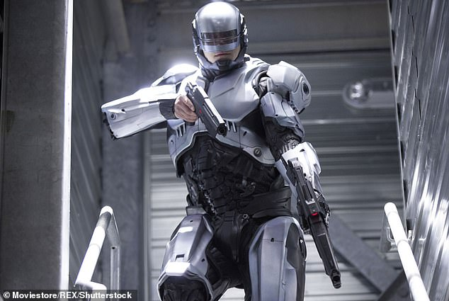 Among the features which could be enhanced on the so-called 'mutant soldiers' are bionic limbs and brain adaptations. Pictured: 2014 film Robocop showcased many of the innovations predicted to be featured in future years