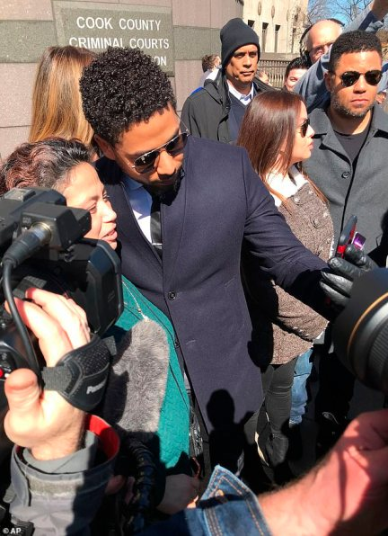 Smollett took selfies with fans outside the court before getting in to a waiting car
