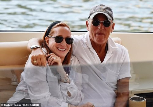 Cute couple:  While Bruce and his wife Patti Scialfa were the epitome of marital bliss as they embraced on a boat, with Patti cutting a chic figure in a white blouse and jeans