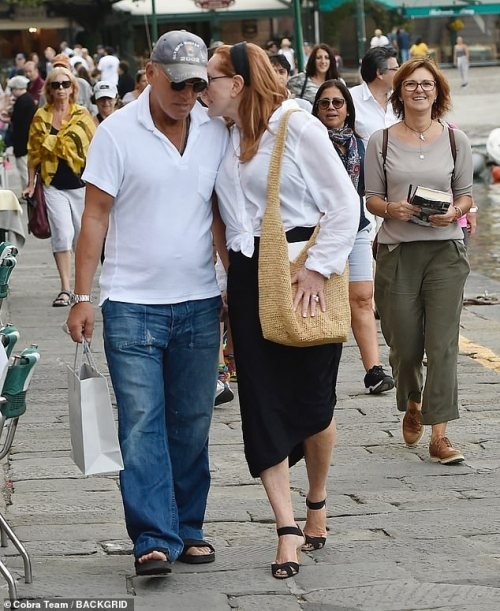 Chat: Patti whispered into her husband's ear as they strolled in the picturesque setting