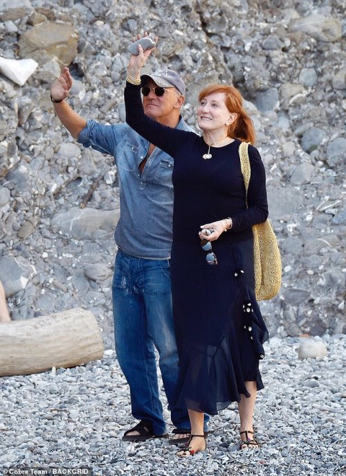 Wave: Bruce and Patti looked delighted as they waved at fans from a pebble beach