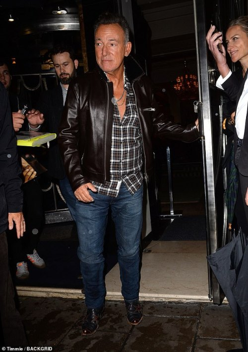 Out and about: Bruce Springsteen, 70, cut a suave figure as he departed Claridge's hotel in London on Saturday evening