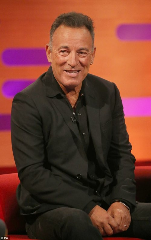 Legend: Bruce looked in high spirits on the show where he sported a black shirt with a matching blazer and trousers