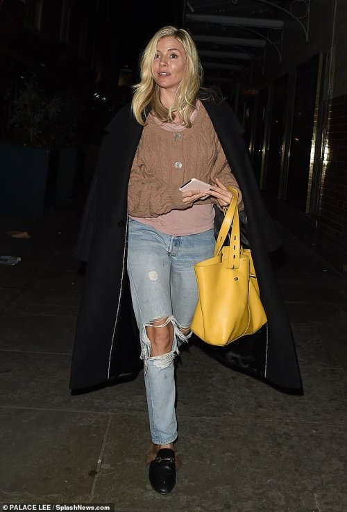 Casual chic:Sienna cut a stylish figure for the evening, donning a mauve jumper underneath a pink t-shirt which she paired with blue, ripped jeans
