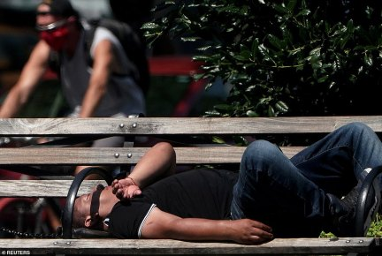 A man rests on a park bench on the Upper West Side in the Manhattan borough of New York City on August 10