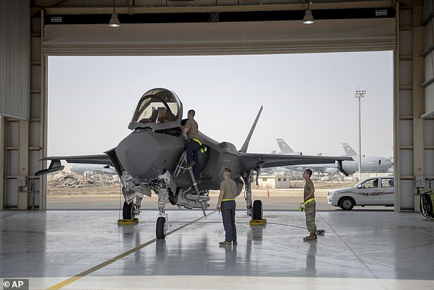 In this Aug. 5, 2019, photo released by the U.S. Air Force, an F-35 fighter jet pilot and crew prepare for a mission at Al-Dhafra Air Base in the United Arab Emirates