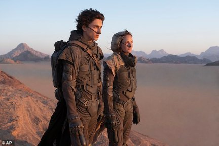Timothee Chalamet, left, and Rebecca Ferguson in a scene from the upcoming 2021 film 'Dune'