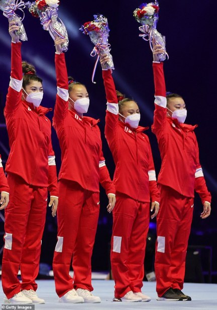 Kara (pictured second from left) is one of four alternates who traveled to Tokyo with the six main members of the gymnastics team, including defending champion Simone, 24