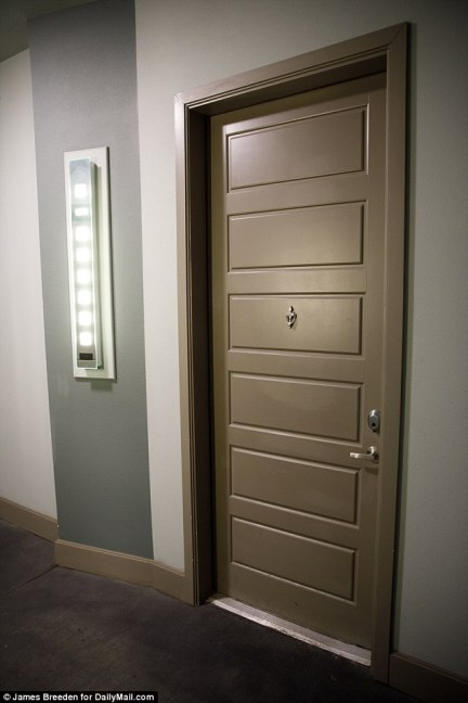 The front door of apartment 1378, directly below Botham Jean's apartment and identified by neighbors as Amber Guyger's front door. The panel to the left of the door has the apartment number that is lit up in neon