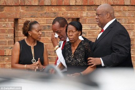 The devastated family of Jean arrive for his funeral at the Greenville Avenue Church of Christ in Richardson, Texas