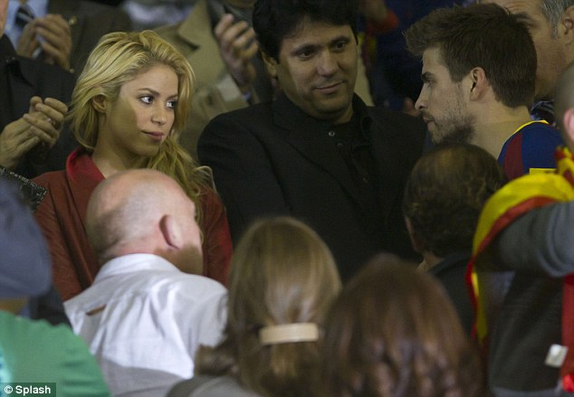 Look of love: Shakira looked heartbroken as her Barcelona footballer boyfriend Gerard Pique