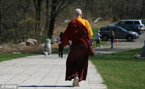 Secret world: A Korean Buddhist monk walking in New York. Another monk, Soo Bok Choi, is accused of keeping a Korean immigrant as a slave for 12 years