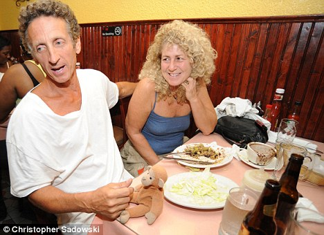 We'll eat and drink to that: Jack Zinzi and Bonni Marcus at their celebratory dinner after being reunited with Bongo